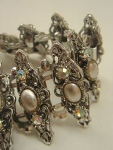 silver color bracelet
