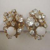 """MIRIAM HASKELL"" gold rhinestone earring"