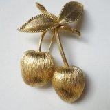 golden apple brooch